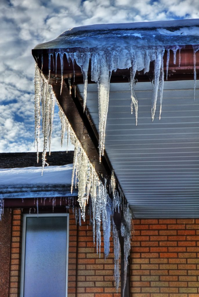 winter icicles clingin on house eaves