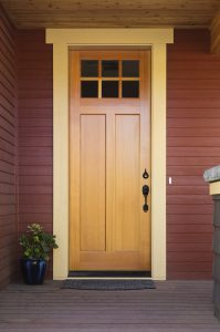 A wooden house door