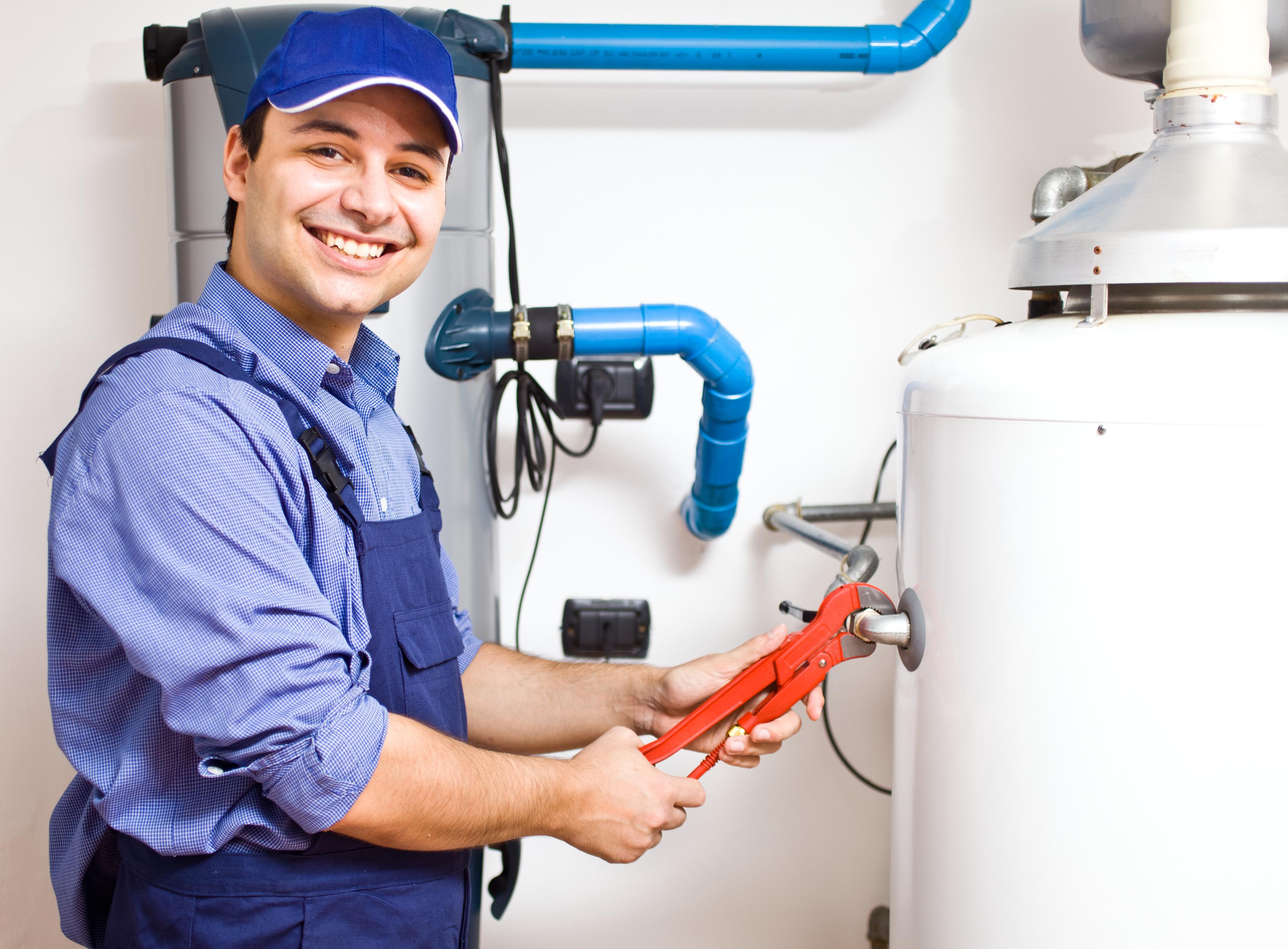 A repairman fixing a water heater