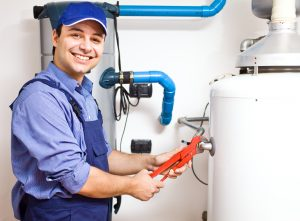A repairman fixing a water heater