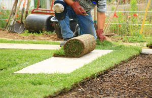 Man installing the turf grass for the shop
