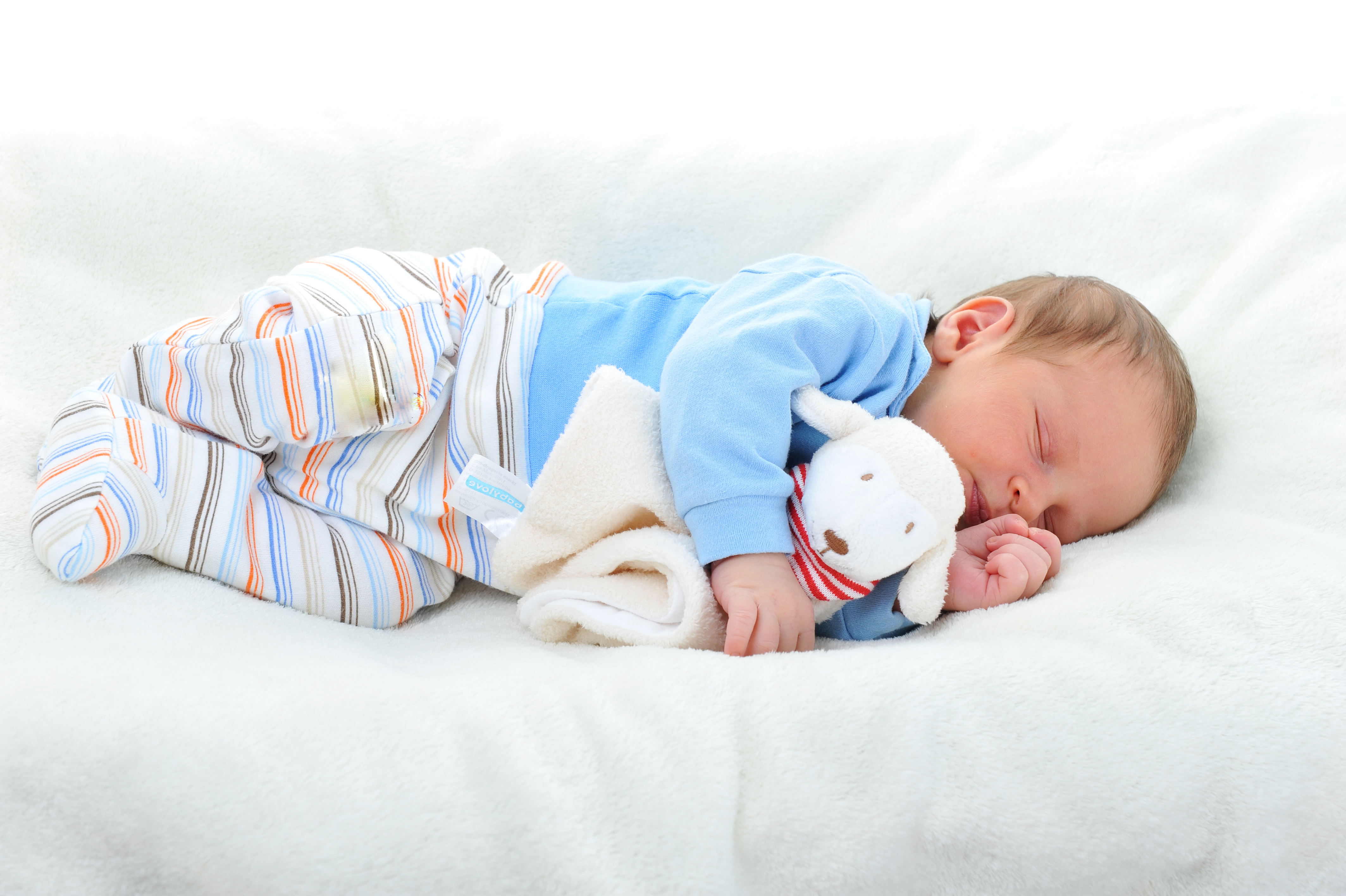 Cute baby sleeping on a comfortable bed