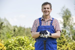 Man ready to take care of the commercial garden