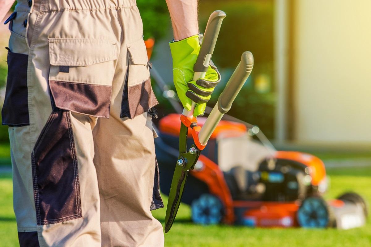 Gardener holding a grass cutter
