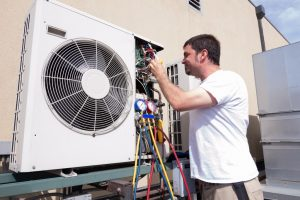 Technician Working on Condensing Unit
