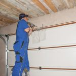 Man repairing garage door