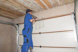 Man repairing garage door