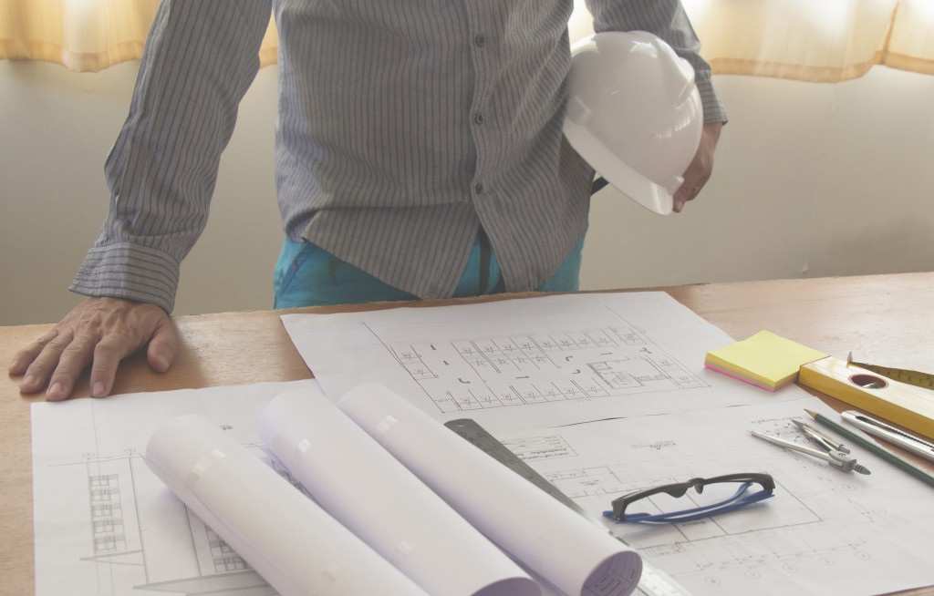 Architect looking at the floor plan