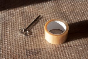 Bubble wrap with tape and scissor