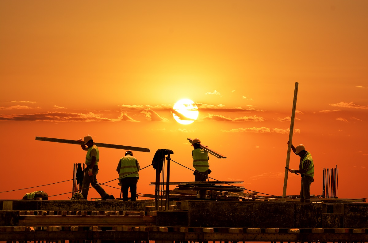 Employees working during sunset
