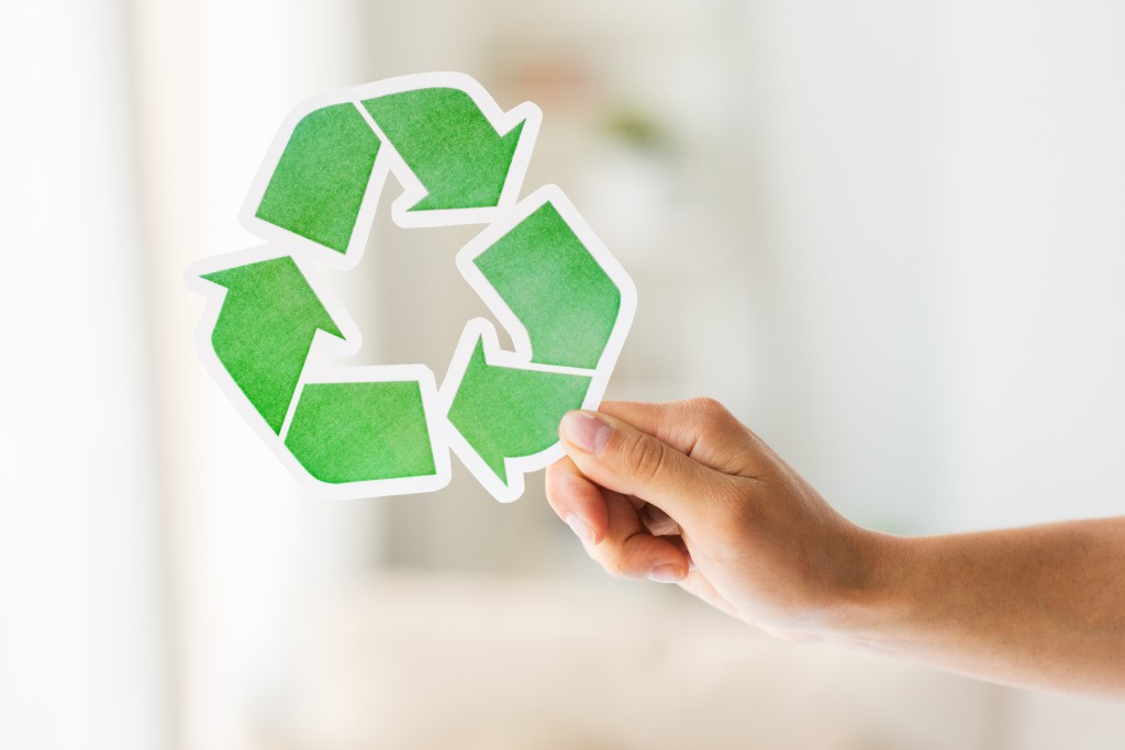 Man holding a recycle paper concept