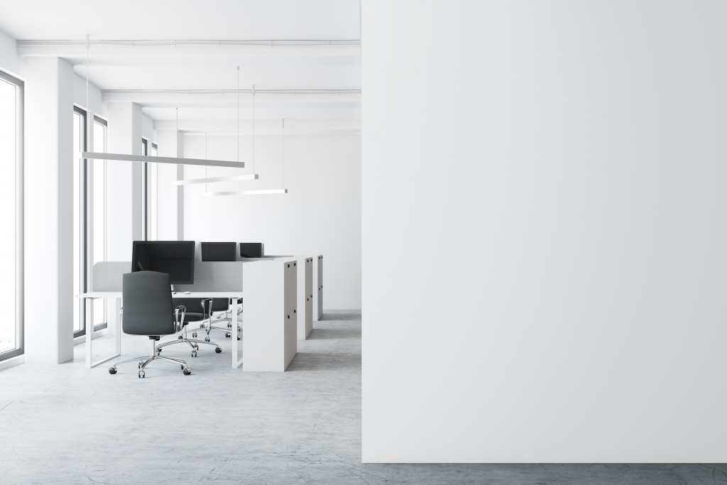 Undecorated office with white walls