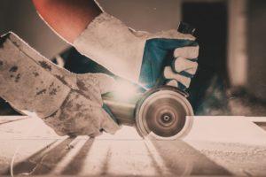 Man cutting tile