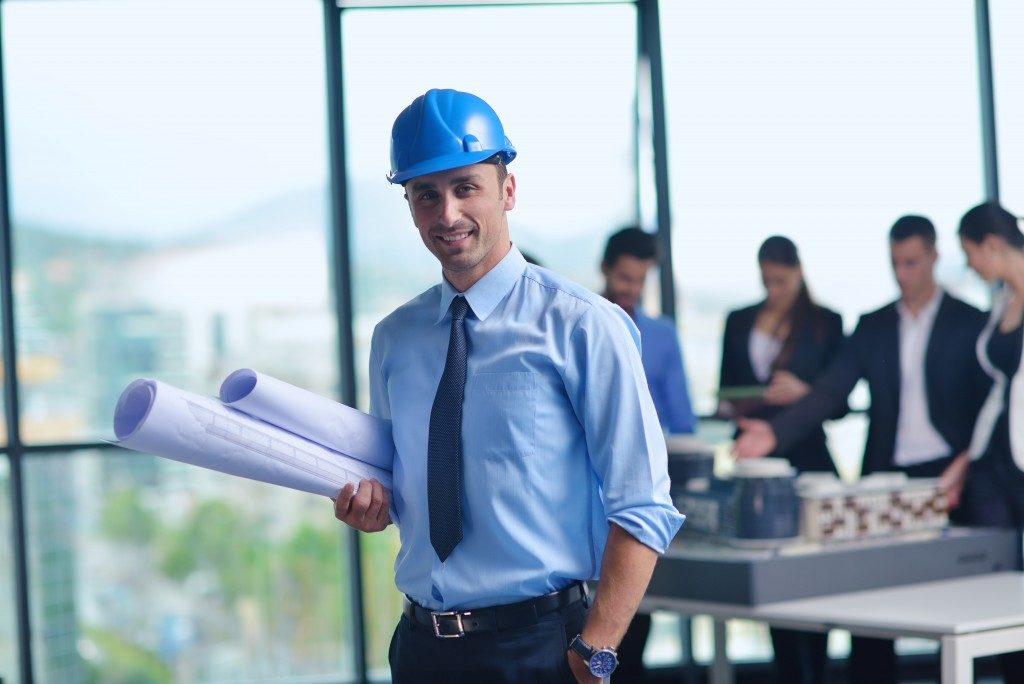 construction company engineer walking after talking to clients