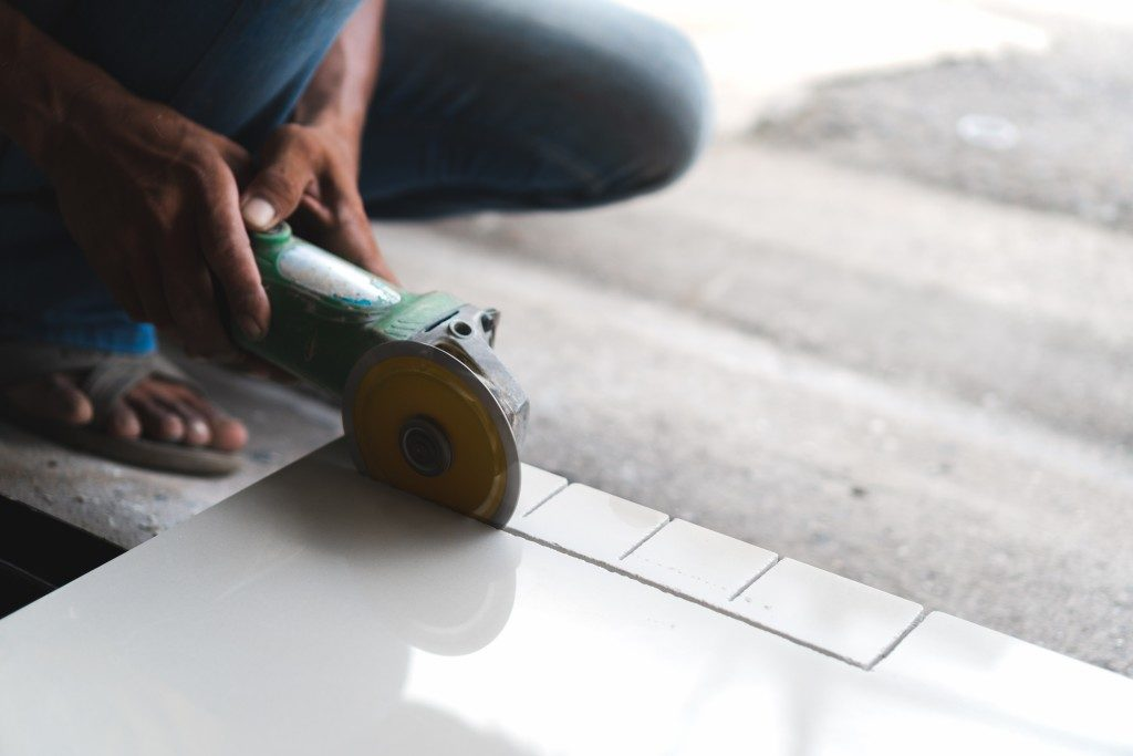 Man cutting ceramic tile