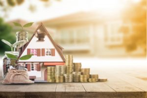 a miniature house and money