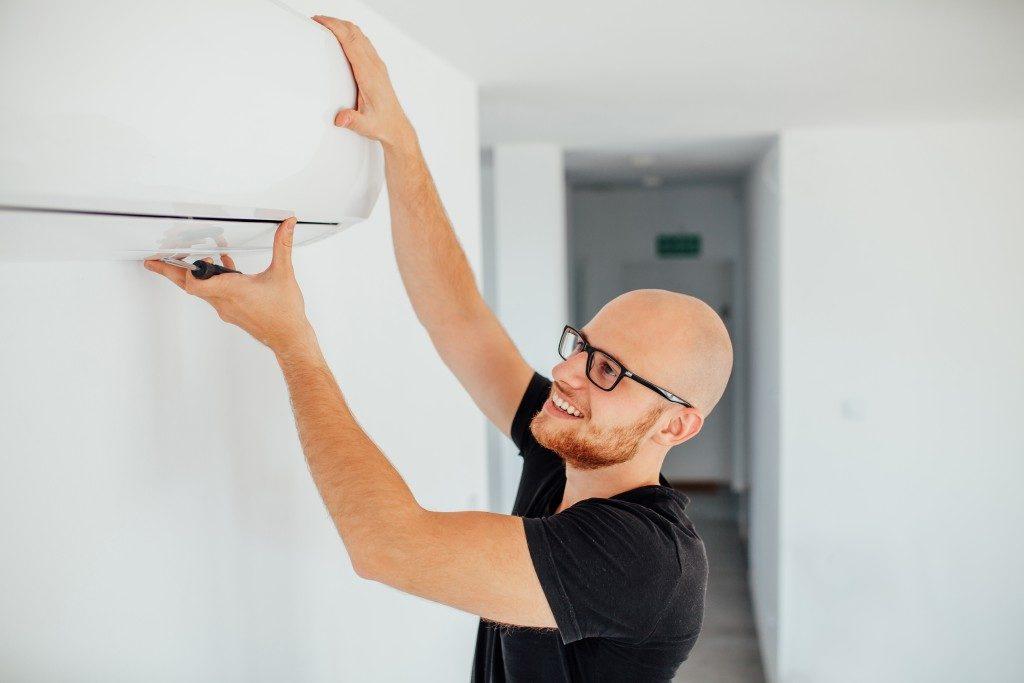 Man checking his air conditioning