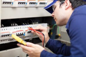Electrician Checking Equipment