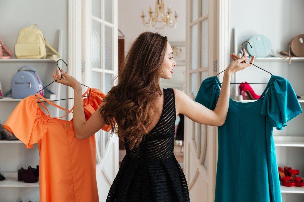 Woman choosing clothes
