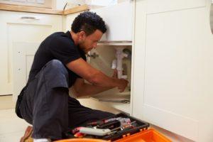 man fixing the plumbing
