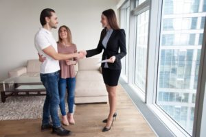 broker welcoming new couple tenant
