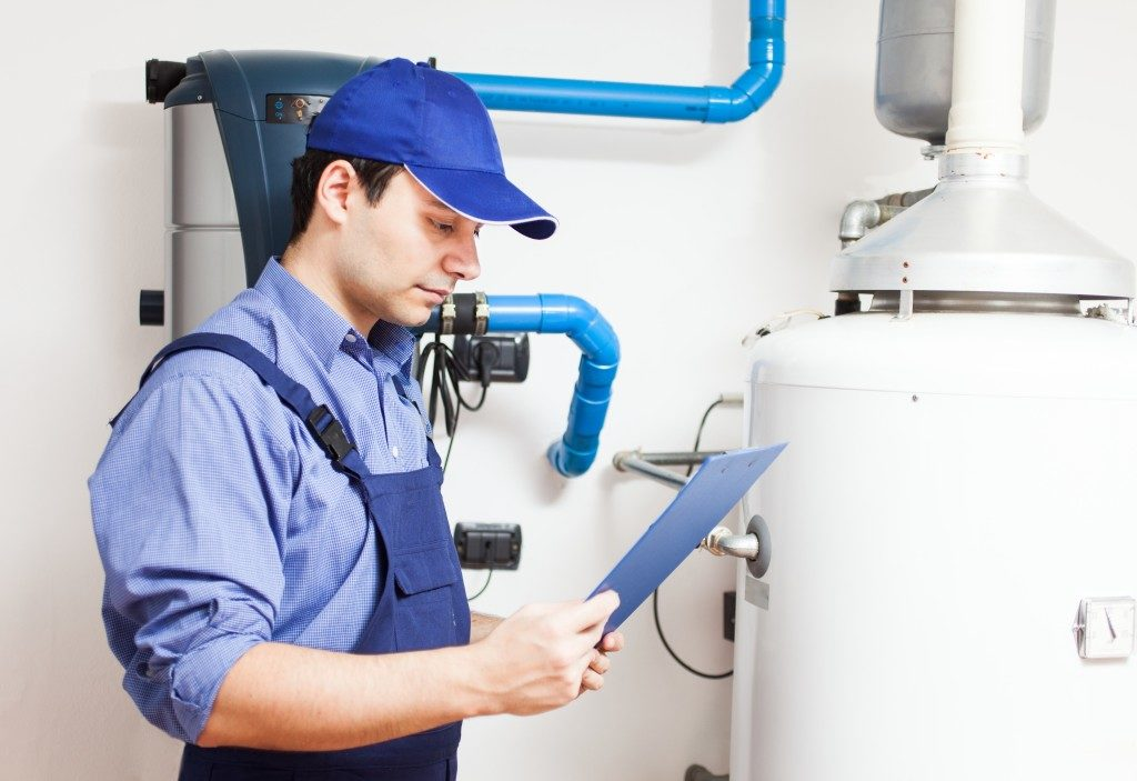Man inspecting heating system