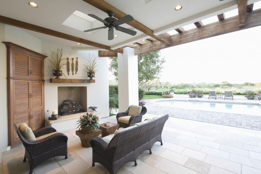 Swimming pool with seating area and fireplace in outdoors