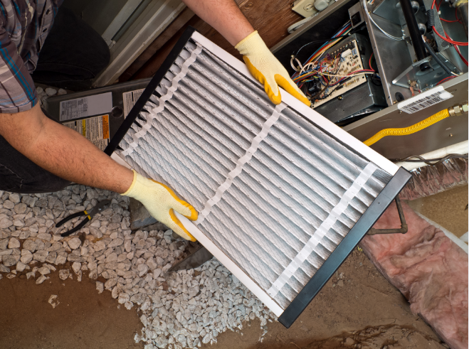man cleaning aircon filter