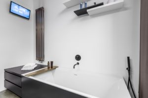 luxury bathtub with television