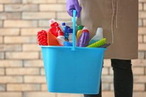 bucket full of cleaning tools