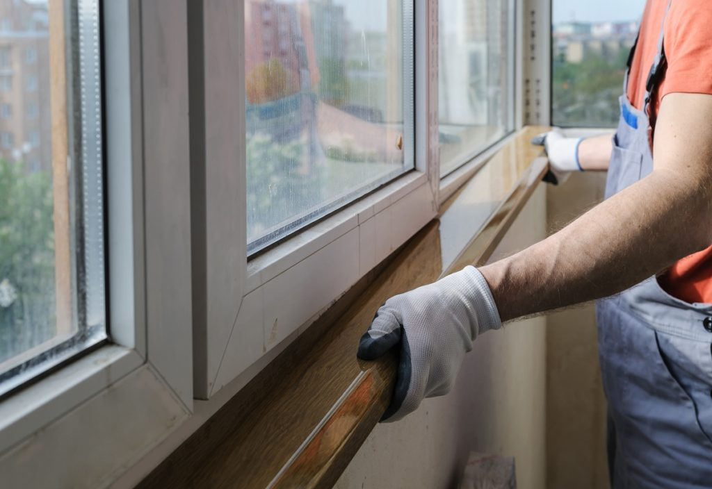 Worker working on window replacement