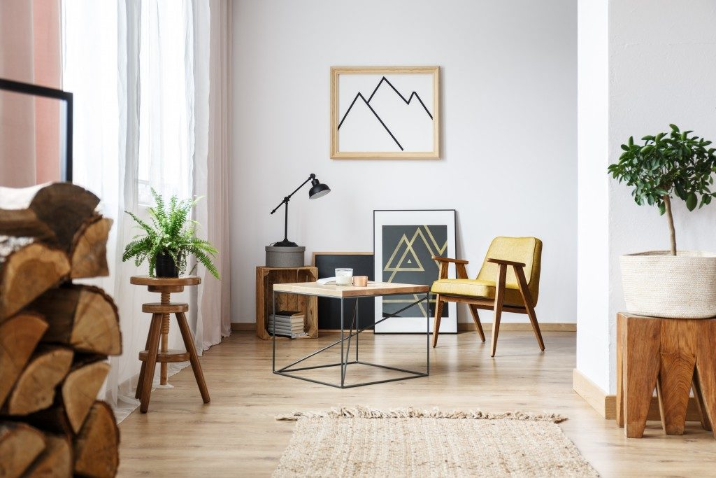 bright room with wood furniture and plants