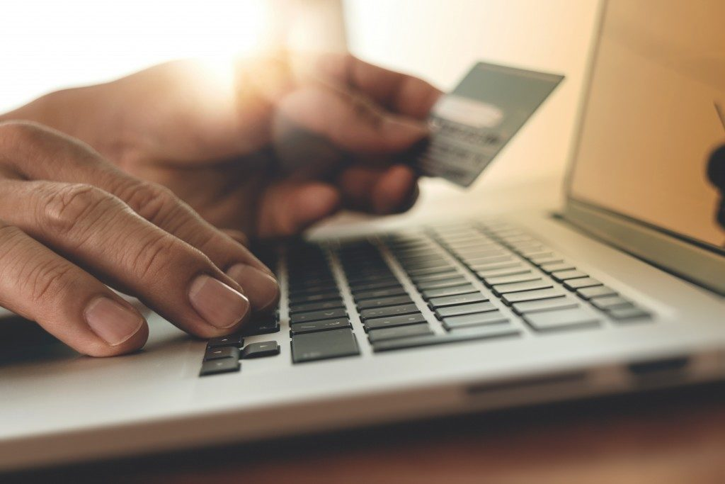 Holding credit card while using laptop