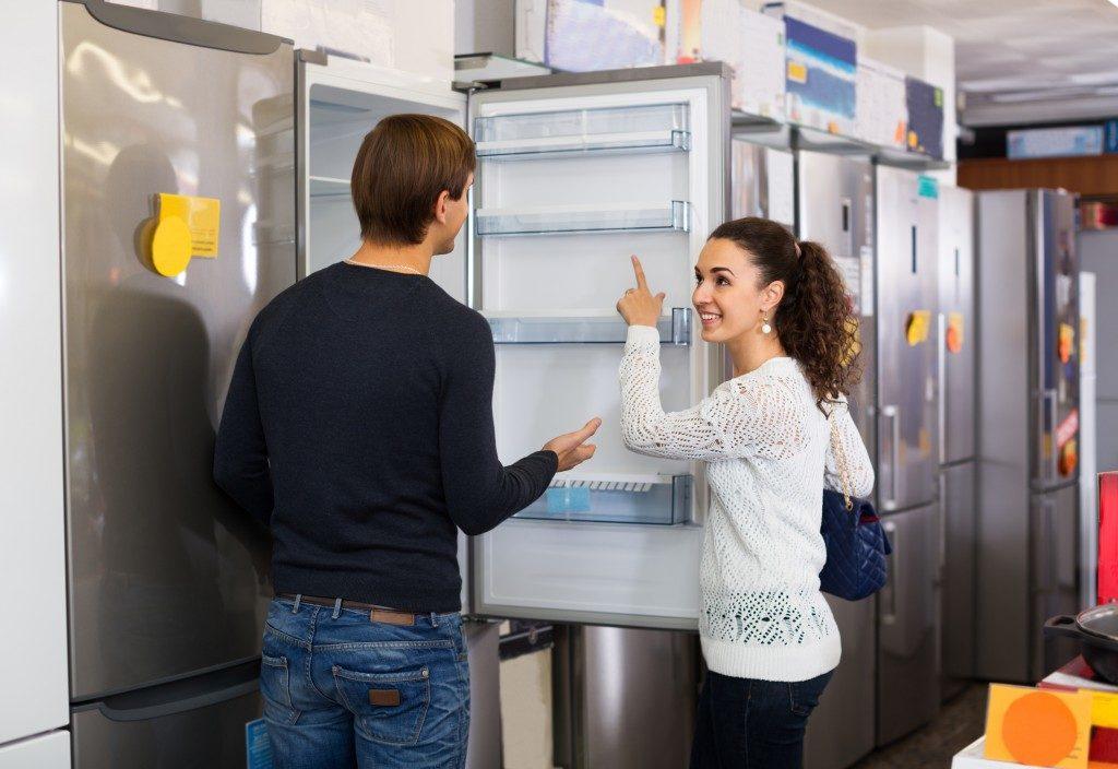 Couple buying refrigerator