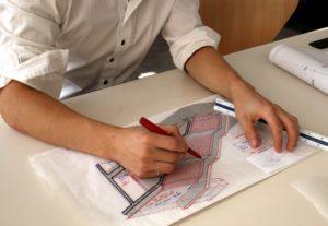 architecture designing a blueprint