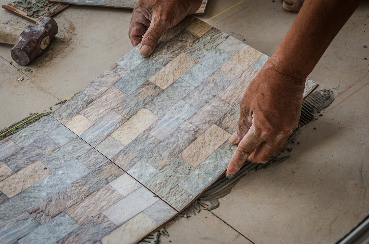 person installing tiles