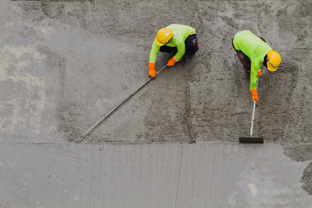 Men smoothing out the concrete
