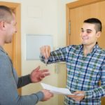 landlord giving keys to tenant