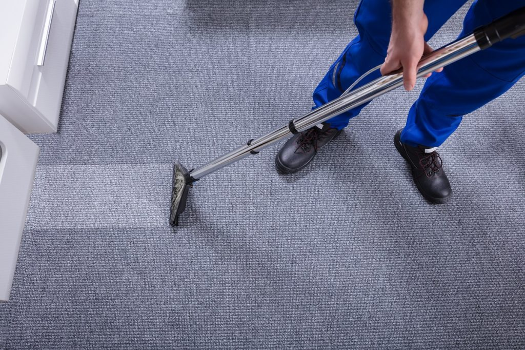guy cleaning the carpet
