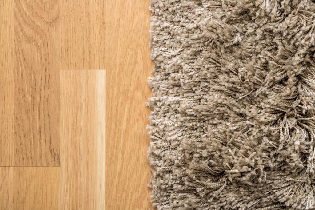 carpet on wooden flooring