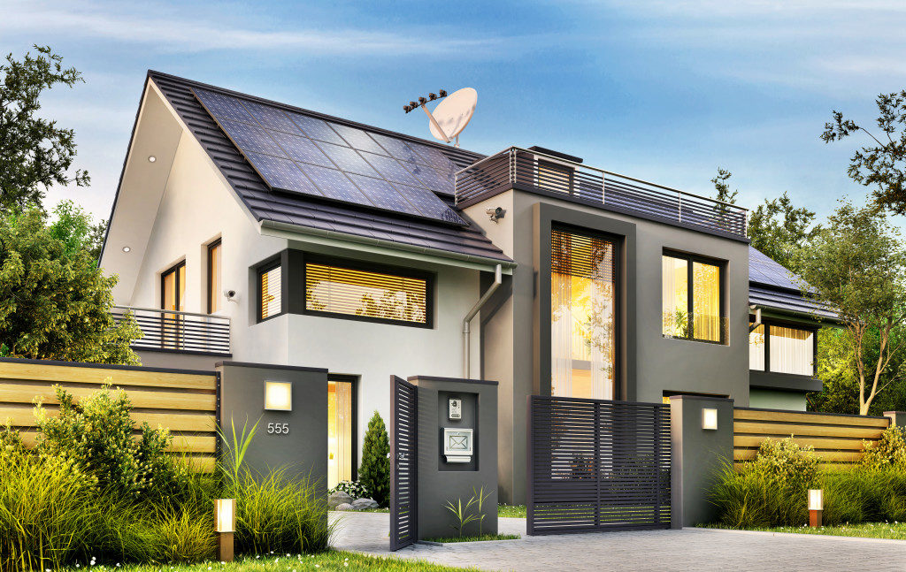 Beautiful modern house with garden and solar panels on the gable roof.